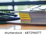 paper stack on the desk related ... | Shutterstock . vector #687296077
