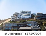 expensive houses on the coast... | Shutterstock . vector #687297007