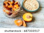oatmeal porridge with pieces of ...   Shutterstock . vector #687333517