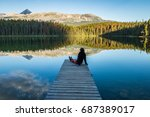 girl sitting on dock  looking... | Shutterstock . vector #687389017
