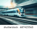 high speed train in motion at... | Shutterstock . vector #687425563
