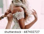 bridesmaid helps fasten a... | Shutterstock . vector #687432727