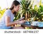 young business woman working on ...   Shutterstock . vector #687486157