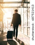 young businessman walking with... | Shutterstock . vector #687521413