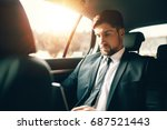handsome businessman using... | Shutterstock . vector #687521443