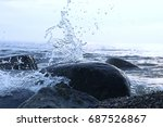 splashes from the waves bumping ... | Shutterstock . vector #687526867