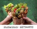 female hands holds three... | Shutterstock . vector #687544993