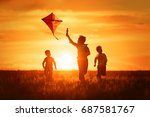 children launch a kite in the... | Shutterstock . vector #687581767