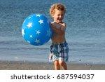 a little boy is holding a ball...   Shutterstock . vector #687594037
