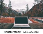 laptop with blank screen on... | Shutterstock . vector #687622303