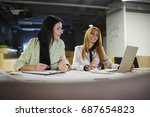cheerful female colleagues... | Shutterstock . vector #687654823