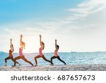 young group man and woman yoga... | Shutterstock . vector #687657673