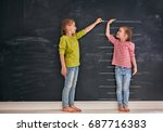 two children sisters play... | Shutterstock . vector #687716383