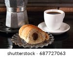 croissant with cocoa filling ... | Shutterstock . vector #687727063