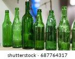 a few bottles of green glass ... | Shutterstock . vector #687764317