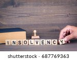 insolvency. wooden letters on... | Shutterstock . vector #687769363