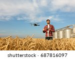 drone hovers in front of farmer ... | Shutterstock . vector #687816097