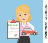 woman shows car insurance.... | Shutterstock . vector #687880303