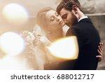 beautiful bride leans to groom... | Shutterstock . vector #688012717