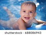 happy child bathing in the pool.... | Shutterstock . vector #688086943