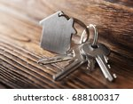 symbol of house with silver key ... | Shutterstock . vector #688100317
