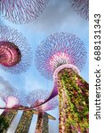 Small photo of Singapore - February 18, 2017: Fantastic bottom view of the Supertree Grove with the Skyway at Gardens by the Bay and the Marina Bay Sands Hotel. Vertical gardens are a popular tourist attraction.