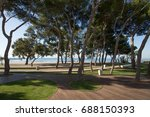 park with pine trees next to... | Shutterstock . vector #688150393