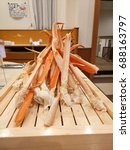 Small photo of Alaskan King Crab Legs on a wooden desk