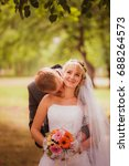 bride and groom in a park... | Shutterstock . vector #688264573