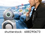 Small photo of Robotics Trends technology and robo advisor concept. Autonomous personal assistant robot and man suit decide to order it with icons graphic.