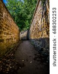 Small photo of Narrow alleyway with green trees