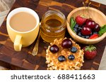 cup of coffee and pastry on... | Shutterstock . vector #688411663