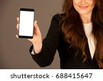 attractive business woman holds ...   Shutterstock . vector #688415647