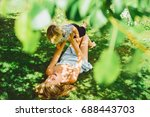 beautiful young mother with a... | Shutterstock . vector #688443703