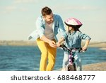 young man teaching his daughter ... | Shutterstock . vector #688468777
