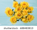 Yellow Roses Bouquet On Wood...