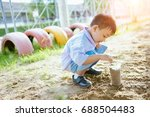 the boys is growing a plant in...   Shutterstock . vector #688504483