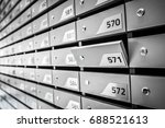 mail boxes filled of leaflets... | Shutterstock . vector #688521613