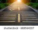 Speed Bumps On Road. With Sunset