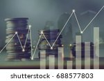 Small photo of double exposure pile of coins and night city, concept in growth, save, finance, account,capital banking and investment in business