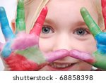 little girl with paint on hands-focus on eyes - stock photo