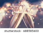 two glasses of champagne... | Shutterstock . vector #688585603
