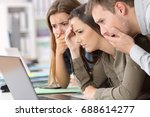 three worried employees reading ... | Shutterstock . vector #688614277