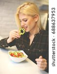 young woman eating healthy food.... | Shutterstock . vector #688637953