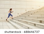 fit woman running up the stairs ... | Shutterstock . vector #688646737