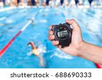 stopwatch holding on hand with... | Shutterstock . vector #688690333