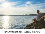 woman on sea beach | Shutterstock . vector #688745797
