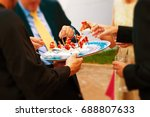 wedding guests eating an... | Shutterstock . vector #688807633