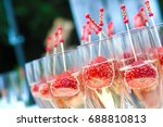 stawberries and champagne cup.... | Shutterstock . vector #688810813