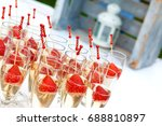 strawberries and champagne cup. ... | Shutterstock . vector #688810897